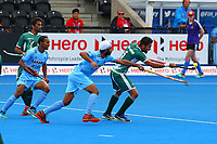 Pakistan's Abu Mahmood controls the ball during the Hockey World League Semi-Final 5-8th place match between Pakistan and India at the Olympic Park, London, England on 24 June 2017. Photo by Steve McCarthy.