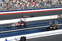 Feb 8, 2015; Pomona, CA, USA; NHRA top fuel driver Steve Torrence (left) races alongside Troy Buff during the Winternationals at Auto Club Raceway at Pomona. Mandatory Credit: Mark J. Rebilas-