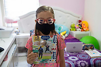 HERMOSILLO, MEXICO - MAY 08: Portrait of Abril Maribel with a photograph of her father Oscar Rai Villa de los Reyes, player of Cimarrones De Sonora, who waits for the end of the pandemic to look at him again on the soccer field on May 8, 2020 in Hermosillo, Mexico. Due to the Coronavirus crisis the Liga MX has announced the cancellation of the Ascenso MX 2019-2020 season and to temporarily suspend promotions and relegations for the next six seasons. (Photo by Luis Gutierrez/Norte Photo/Getty Images)