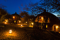 Boma (guest cottages) at twilight, Serengeti Serena Lodge, Serengeti National Park, Tanzania