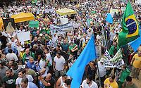 """SAO PAULO, SP, 22.03.2014 - MARCHA DA FAMILIA - Manifestantes durante a nova versão da """"A Marcha da Família com Deus pela Liberdade"""", na Praça da República, no centro de São Paulo, na tarde deste sábado (22). O ato relembra a marcha anticomunista que apoiava o golpe militar realizada há 50 anos. O grupo pede a volta dos militares ao poder. (Foto: Vanessa Carvalho / Brazil Photo Press)."""