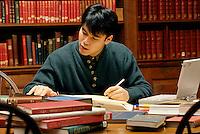 Asian-American student at Dunster library, Harvard University, Cambridge, MA