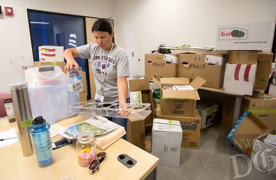 NWA Media/JASON IVESTER --08/21/2014--<br /> Joplin Schools Nursing Coordinator Holly Toney unpacks in the nurses office on Thursday, Aug. 21, 2014, inside the new Joplin High School in Joplin, Mo. The school was originally scheduled to open with the rest of the school district on Monday, Aug. 25, but was pushed back to Tuesday, Sept. 2.
