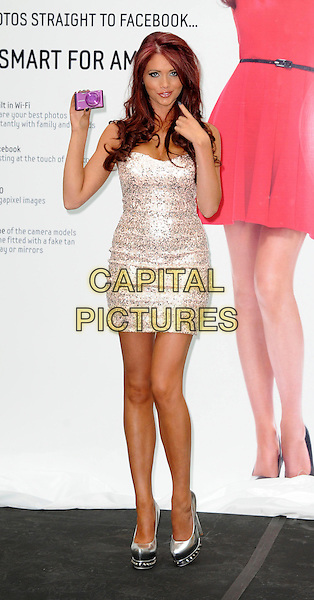 Amy Childs.launches Samsung's new range of SMART cameras at the at Westfield shopping centre in White City. London, England..May 1st, 2012.full length silver strapless dress sequins sequined hand finger shoes.CAP/WIZ.© Wizard/Capital Pictures.
