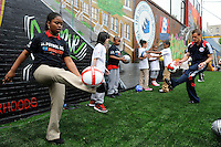Seth Stammler of the New York Red Bulls teaches during a soccer clinic prior to a press conference announcing former President Bill Clinton (not pictured) as the honorary chairman of the USA Bid Committee to host the FIFIA World Cup in 2018 or 2022 at the FC Harlem Field in Harlem, NY, on May 17, 2010.