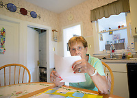 EDITORS NOTE: DIBRINO WAS CONCERNED ABOUT SHOWING HER FACE IN THE IMAGES: Carmella DiBrino looks through paperwork after a scammer bilked her of $11,000 in gift cards  Tuesday, September 05, 2017 in Hatboro, Pennsylvania. Someone pretending to be her grandson called her on the phone and said they needed money to get out of jail and pay a lawyer. She then purchased 11,000 in gift cards at Walmart and read numbers off the back of the cards to the scammer, who hasn't been caught. She is fighting Walmart and her bank to get the money back. (WILLIAM THOMAS CAIN / For The Philadelphia Inquirer)