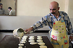A Palestinian baker makes small traditional pancakes on the first day of the holy month of Ramadan, in the northern West Bank city of Ramallah. Most of the world's 1.2 billion Muslims began Ramadan today, a holy month of dawn-to-dusk fasting, festivities -- and abstinence. The start of Ramadan, the ninth and holiest month of the Muslim calendar, is traditionally determined by the sighting of a new crescent moon, often dividing rival Islamic countries and sects over the exact date.