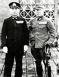 Takijiro Onishi (2 June 1891 - 16 August 1945) was an admiral in the Imperial Japanese Navy during World War II, who came to be known as the father of the kamikaze. At the end of the War Onishi committed ritual suicide (seppuku) in his quarters following the surrender of Japan. In his suicide note he apologized to the approximately 4,000 pilots whom he had sent to their deaths, and urged all young civilians who had survived the war to work towards rebuilding Japan and peace among nations. Pictured here with Saburo Endo (right). (Photo by Kingendai Photo Library/AFLO)