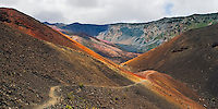 Hiking trail along the orange colored lava sand by the bottomless pit cinder cone in HALEAKALA NATIONAL PARK on Maui in Hawaii