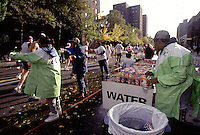 New Yor, NY -- Volunteers offer water to runners during the New York City Marathon