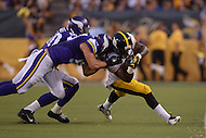 Canton, Ohio - August 9, 2015: Cameron Stingily, #30 of the Pittsburgh Steelers, runs the ball as he is tackled by Audie Cole, #57 of the Minnesota Vikings, during a preseason game held at the Hall of Fame stadium in Canton, Ohio, August 9, 2015  (Photo by Don Baxter/Media Images International)