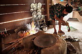 BELIZE, Punta Gorda, Toledo District, Desiree Mes prepares a chicken for lunch in her home, San Jose Maya Village