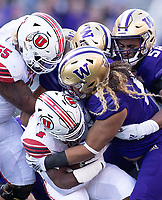 The Husky defense was stout for much of the first half.