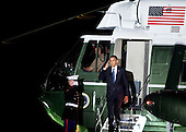 United States President Barack Obama salutes while walking off Marine One on the South Lawn of the White House, Thursday, August 5, 2010 in Washington, DC.  Obama was returning from Chicago where he spent his birthday, visited a Ford motor company Chicago assembly plant and attended a Democratic National Committee fundraiser. .Credit: Brendan Smialowski - Pool via CNP