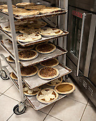 November 25, 2009. Wake Forest, North Carolina.. Ilya Koltusky of Sweet Loralee Pastries prepares Thanksgiving pies.. Pumpkin, cherry, sweet potato and pecan pies await buyers.