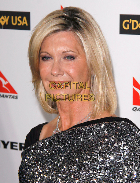 OLIVIA NEWTON-JOHN .Attending the 2010 G'Day USA Australia Week Black Tie Gala held at the Hollywood & Highland Grand Ballroom, Hollywood, California, USA, .16th January 2010. .arrivals portrait headshot black sequined sequin                         .CAP/RKE/DVS .©DVS/RockinExposures/Capital Pictures