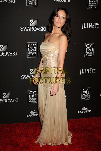 MINKA KELLY.Attending the 12th Annual Costume Designers Guild Awards held at the Beverly Hilton Hotel.  .Beverly Hills, California, USA,  .25th February 2010 .arrivals full length beige dress long maxi corset strapless ruched gold pleated side lace-up .CAP/ADM/BP.©Byron Purvis/AdMedia/Capital Pictures.