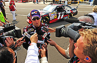 Aug. 7, 2009; Watkins Glen, NY, USA; NASCAR Sprint Cup Series driver Denny Hamlin is interviewed after making his lap during qualifying for the Heluva Good at the Glen. Mandatory Credit: Mark J. Rebilas-