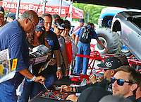 Jun 5, 2015; Englishtown, NJ, USA; NHRA Fans lined up at an autograph session in the Toyota display during qualifying for the Summernationals at Old Bridge Township Raceway Park. Mandatory Credit: Mark J. Rebilas-