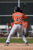 Outfielder Andres Aguilar (45) of the Baltimore Orioles organization during a minor league spring training camp day game on March 23, 2014 at Buck O'Neil Complex in Sarasota, Florida.  (Mike Janes/Four Seam Images)