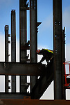 A steel worker waits for another beam to place at the new patient tower at the Williamsport Regional Medical Center.