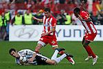 Pavle Ninkov, center and Awal Issah, from Red Star Belgrade tackles Radosav Petrovic,  during the Serbian League soccer match in Belgrade, Serbia, Saturday, October  24, 2010. (Srdjan Stevanovic/Starsportphoto.com)