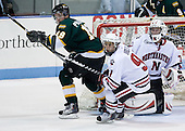 Devan Praught (St. Thomas - 19), Robbie Vrolyk (NU - 91), Chris Rawlings (NU - 37) - The Northeastern University Huskies defeated the St. Thomas Tommies 7-5 in their exhibition match on Saturday, October 3, 2009, at Matthews Arena in Boston, Massachusetts.