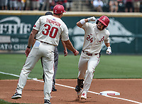 NWA Democrat-Gazette/CHARLIE KAIJO Arkansas Razorbacks outfielder Dominic Fletcher (24) scores during game two of the College Baseball Super Regional, Sunday, June 9, 2019 at Baum-Walker Stadium in Fayetteville. Ole Miss forces a game three with a 13-5 win over the Razorbacks