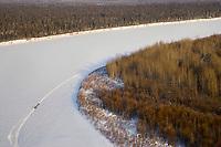 Aerial of sled dog team running on Kuskokwim River from Nikolai to McGrath 2006 Iditarod Western AK