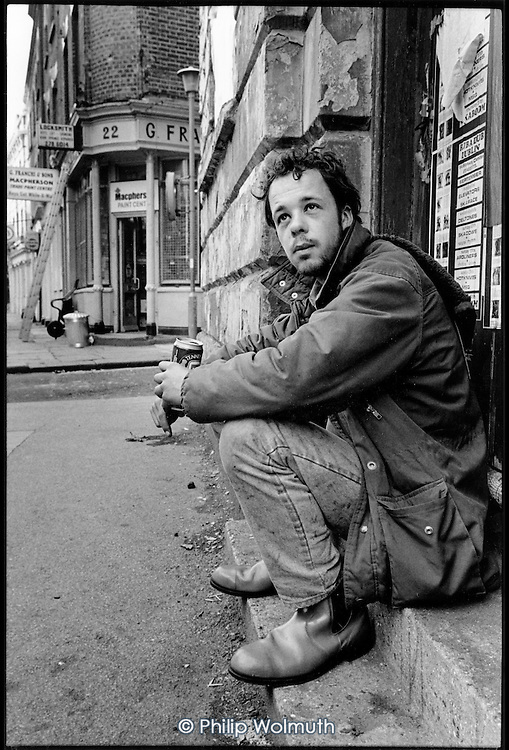 Young homeless man in Pancras Road, King's Cross, London 1989.