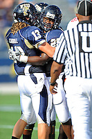 9 October 2010:  FIU running back Darriet Perry (28) celebrates his second-quarter touchdown with teammate Wesley Carroll (13) as the FIU Golden Panthers defeated the Western Kentucky Hilltoppers, 28-21, at FIU Stadium in Miami, Florida.