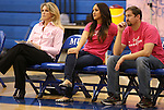 Marymount Head Coach Beth Ann Wilson and Assistant Coaches Johannah Zabal and Victor Troyan watch a college volleyball match against Shenandoah at Marymount University in Arlington, Vir., on Tuesday, Oct. 8, 2013.<br /> Photo by Cathleen Allison