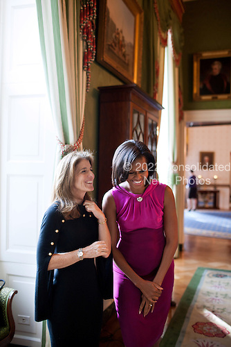 First Lady Michelle Obama waits with Caroline Kennedy Schlossberg in the Green Room of the White House before making remarks to the White House Historical Association, October 31, 2011. The White House hosted a reception to honor the group's 50th anniversary. .Mandatory Credit: Lawrence Jackson - White House via CNP