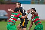 Robert Wallis gets surrounded by Waiuku defenders Ray Taupo and Sio Petelo. Counties Manukau Premier Club Rugby game between Waiuku and Bombay, played at Waiuku on Saturday July 5th 2010. Waiuku won 59 - 14 after trailing 12 - 14 at halftme.