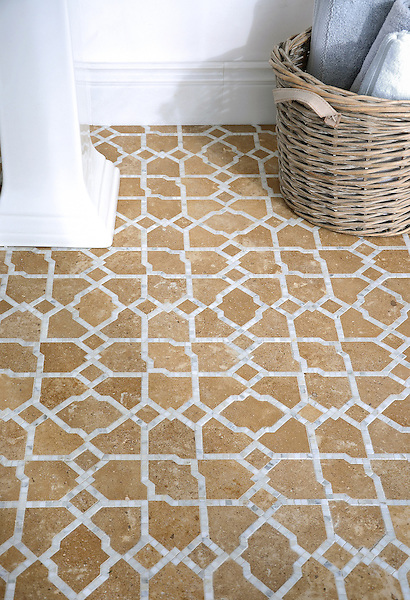 Fasaldo, a natural stone waterjet mosaic shown in honed Lavigne and polished Calacatta. Designed by Paul Schatz for New Ravenna.<br />