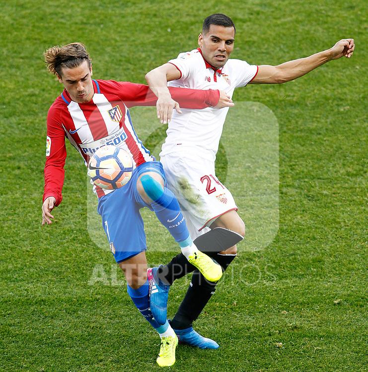 Atletico de Madrid's Antoine Griezmann (l) and Sevilla FC's Gabriel Mercado during La Liga match. March 19,2017. (ALTERPHOTOS/Acero)