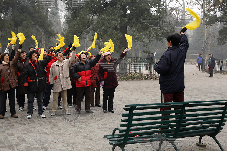People practising patriotic slogans on a Sunday morning at the Temple of Heaven Park.  ...