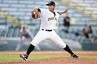 Bradenton Marauders pitcher Orlando Castro (15) delivers a pitch during a game against the Jupiter Hammerheads on June 25, 2014 at McKechnie Field in Bradenton, Florida.  Bradenton defeated Jupiter 11-0.  (Mike Janes/Four Seam Images)