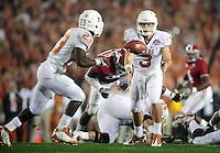 Jan 7, 2010; Pasadena, CA, USA; Texas Longhorns quarterback Garrett Gilbert (3) pitches to running back Tre' Newton (23) during the second quarter of the 2010 BCS national championship game at the Rose Bowl.  Mandatory Credit: Mark J. Rebilas-