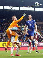 Leicester City's Kasper Schmeichel climbs over Burnley's Chris Wood in a failed attempt to win the ball <br /> <br /> Photographer Rich Linley/CameraSport<br /> <br /> The Premier League - Burnley v Leicester City - Saturday 16th March 2019 - Turf Moor - Burnley<br /> <br /> World Copyright © 2019 CameraSport. All rights reserved. 43 Linden Ave. Countesthorpe. Leicester. England. LE8 5PG - Tel: +44 (0) 116 277 4147 - admin@camerasport.com - www.camerasport.com