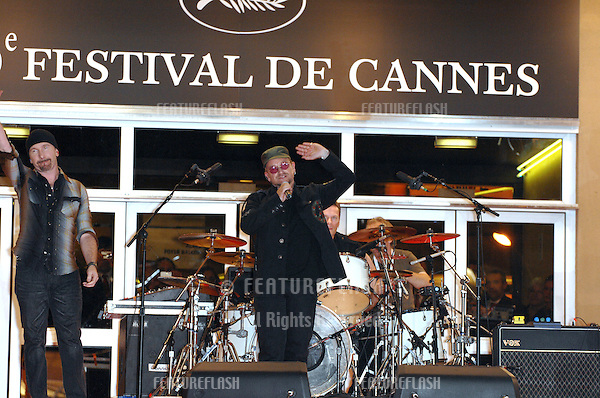 "Bono & U2 performing on the steps of the Palais des Festivals prior to the screening of their new movie ""U2 3D"" at the 60th Annual International Film Festival de Cannes. .May 19, 2007  Cannes, France..© 2007 Paul Smith / Featureflash"