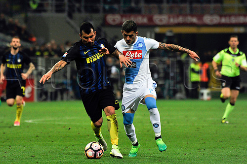 April 30th 2017, San Siro Stadium, Milan, Italy; Elseid Hysaj of Napoli competes for the ball with Gary Medel of Inter  during the Serie A football match, Inter Milan versus Napoli; Napoli won the game by a score of 0-1