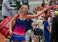 Paris, France, 26 June, 2016, Tennis, Roland Garros,  Kiki Bertens (NED) throws a towel to her fans<br /> Photo: Henk Koster/tennisimages.com