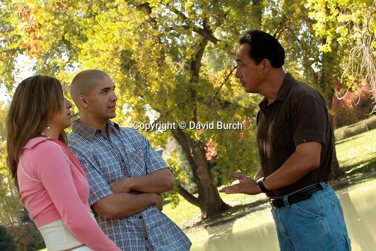 Hispanic man communicating with  his children