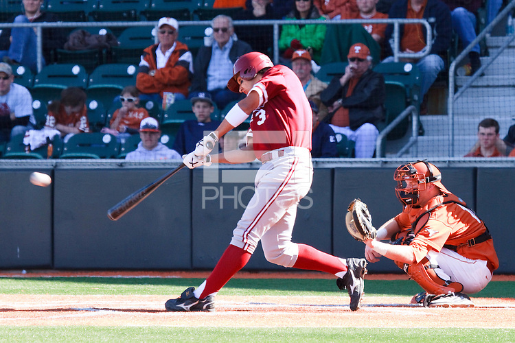 AUSTIN, TEXAS-March 6, 2011:  Kenny Diekroeger of Stanford slaps a single to center field during the game against the Texas Longhorns, at Disch-Falk field in Austin, Texas.  Texas defeated Stanford 4-2.