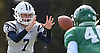 Charlie McKee #7, Oceanside freshman quarterback, takes a snap during the third quarter of the Nassau County football Conference I semifinals against Farmingdale at Shuart Stadium in Hempstead on Saturday, Nov. 10, 2018.