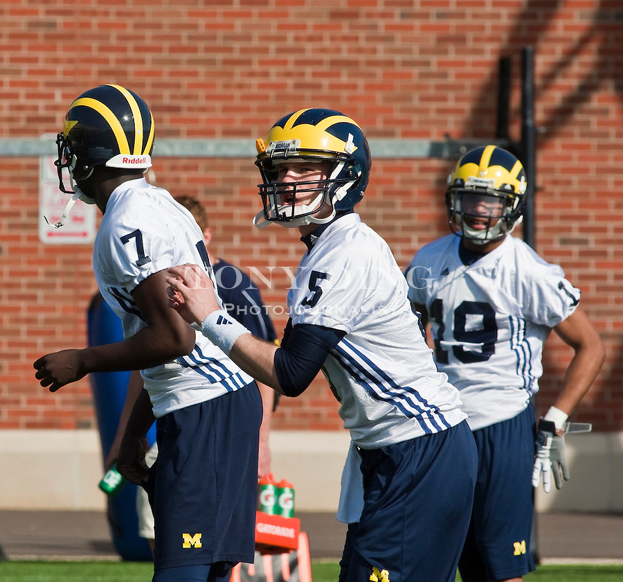 Michigan quarterbacks Devin Gardner (7) and Tate Forcier (5) participate in a passing drill, as slot receiver Kelvin Grady (19) watches on the first day of spring football practices, Tuesday, March 16, 2010, in Ann Arbor, Mich. (AP Photo/Tony Ding)