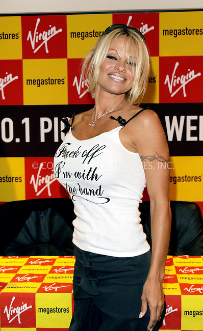 """WWW.ACEPIXS.COM . . . . .  ... . . . . US SALES ONLY . . . . ...LONDON, UK, OCTOBER 21, 2004: Pamela Anderson at a signing of her new book 'Star' at Virgin Megastore. Pamela's tank top reads, """"Fuck off I'm with the band."""" Please byline: F. DUVAL-FAMOUS-ACE PICTURES.... . . . .  ....Ace Pictures, Inc:  ..Alecsey Boldeskul (646) 267-6913 ..Philip Vaughan (646) 769-0430..e-mail: info@acepixs.com..web: http://www.acepixs.com"""