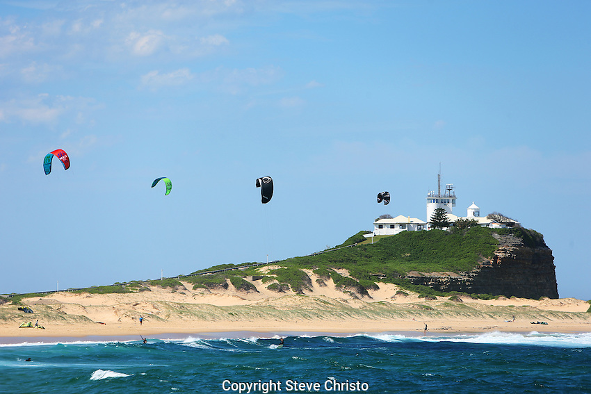 Kitesurfing or kiteboarding is a surface water sport combining aspects of wakeboarding, windsurfing, surfing, paragliding, and gymnastics into one extreme sport. Sydney, Australia, Monday 9th December 2013. (Photo: Steve Christo)