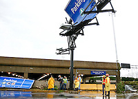 Crews assess the damage near a parking garage at Lambert- St. Louis International Airport on April 23, 2011 after storms last night damaged both the interior and exterior of the airport. The airport was closed all day today and officials hope to reopen tomorrow. REUTERS/Sarah Conard (UNITED STATES)